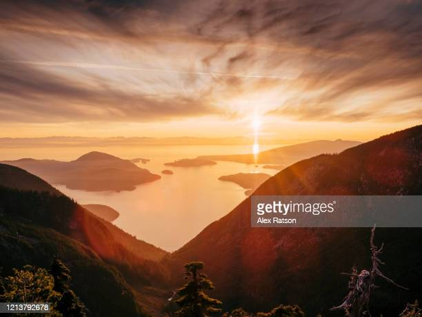 howe sound at sunset from high above lions bay, british columbia, canada - moody sky stock pictures, royalty-free photos & images