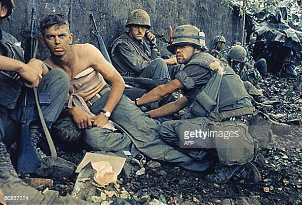 R Howe treats the wounds of Private First Class DA Crum H Company 2nd Battalion Fifth Marine Regiment During Operation Hue City in Vietnam 06...