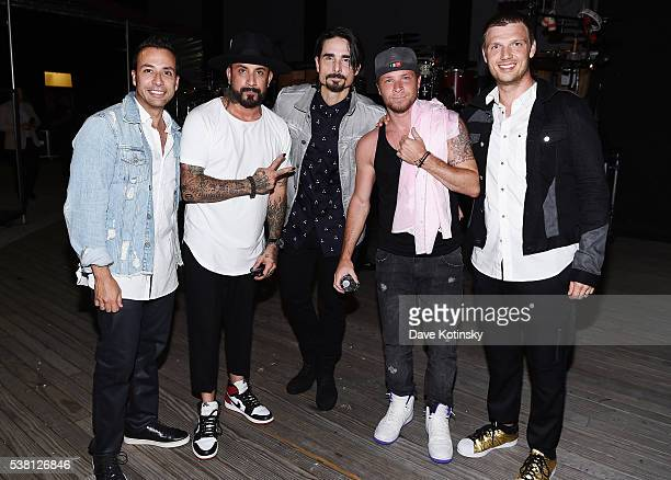 Howie Dorough A J McLean Kevin Richardson Brian Littrell and Nick Carter of Backstreet Boys pose for a photo backstage during 1035 KTU's KTUphoria...