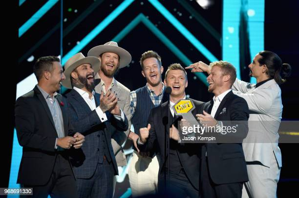 Howie Dorough AJ McLean Tyler Hubbard Brian Kelley Nick Carter Brian Littrell and Kevin Richardson accept an award onstage at the 2018 CMT Music...