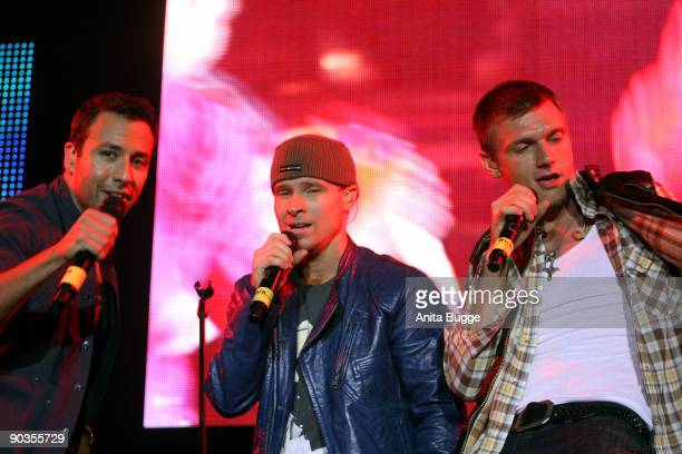 """Howie Dorough, Brian Littrell and Nick Carter of the Backstreet Boys perform live during the """"Stars for free"""" concert at Wuhlheide stadion on..."""