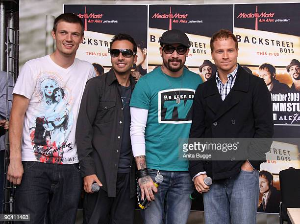 Howie Dorough, Nick Carter; AJ Mclean and Brian Littrell of the Backstreet Boys pose for the photographers prior to their autograph session on...