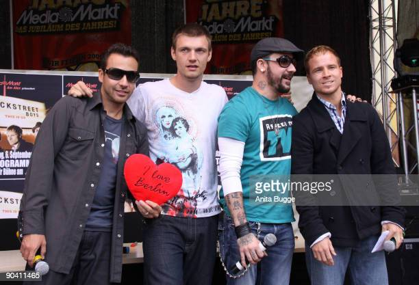 Howie Dorough, Nick Carter, AJ Mclean and Brian Littrell of the Backstreet Boys pose for the photographers prior to their autograph session on...