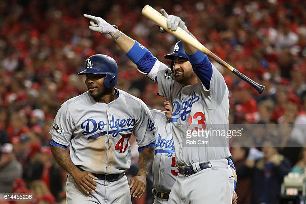 Howie Kendrick and Adrian Gonzalez of the Los Angeles Dodgers celebrate after teammate Justin Turner hit a two run RBI triple in the seventh inning...