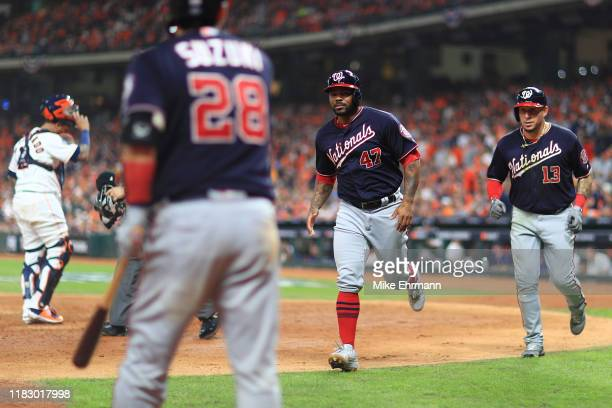 Howie Kendrick and Asdrubal Cabrera of the Washington Nationals score on a hit by Ryan Zimmerman against the Houston Astros during the seventh inning...