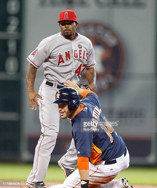 Howie Kendrick of the Los Angeles Angels of Anaheim and JD Martinez of the Houston Astros look back at first base after a double play in the second...