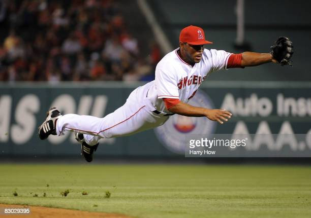 Howie Kendrick of the Los Angeles Angels of Anaheim dives for a line drive against the Texas Rangers during the second inning at Angels Stadium on...