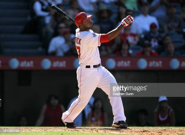 Howie Kendrick of the Los Angeles Angels of Anaheim hits a three run walk off home run in the ninth inning against the Seattle Mariners on May 30...