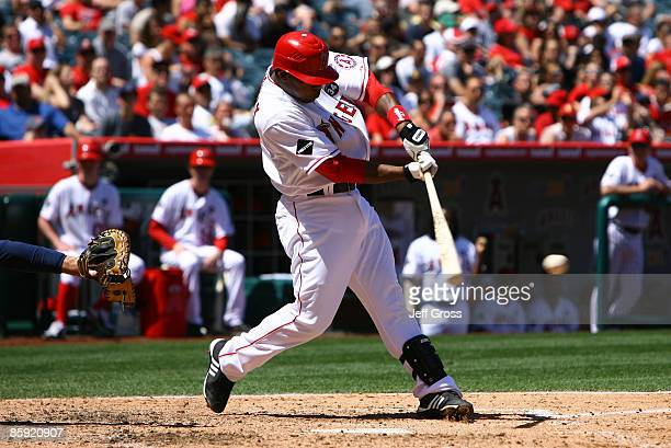 Howie Kendrick of the Los Angeles Angels of Anaheim hits an RBI single in the third inning against the Boston Red Sox at Angel Stadium on April 12,...