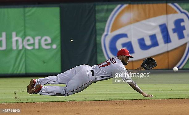 Howie Kendrick of the Los Angeles Angels of Anaheim stops a ball hit by Rougned Odor of the Texas Rangers for the final out of the game at Globe Life...
