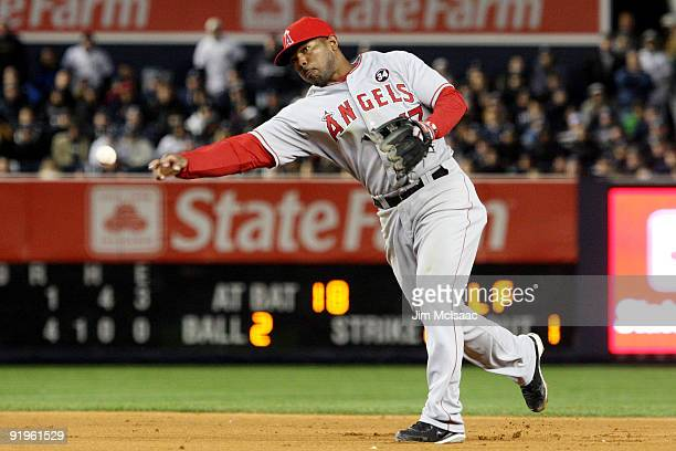 Howie Kendrick of the Los Angeles Angels of Anaheim throws a pitch against the New York Yankees in the eighth inning of Game One of the ALCS during...