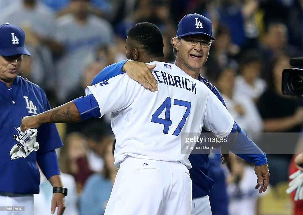 Howie Kendrick #47 of the Los Angeles Dodgers celebrates with manager Don Mattingly after hitting a walk off single in the ninth inning against the Arizona Diamondbacks at Dodger Stadium on June 10, 2015 in Los Angeles, California. The Dodgers won 7-6.
