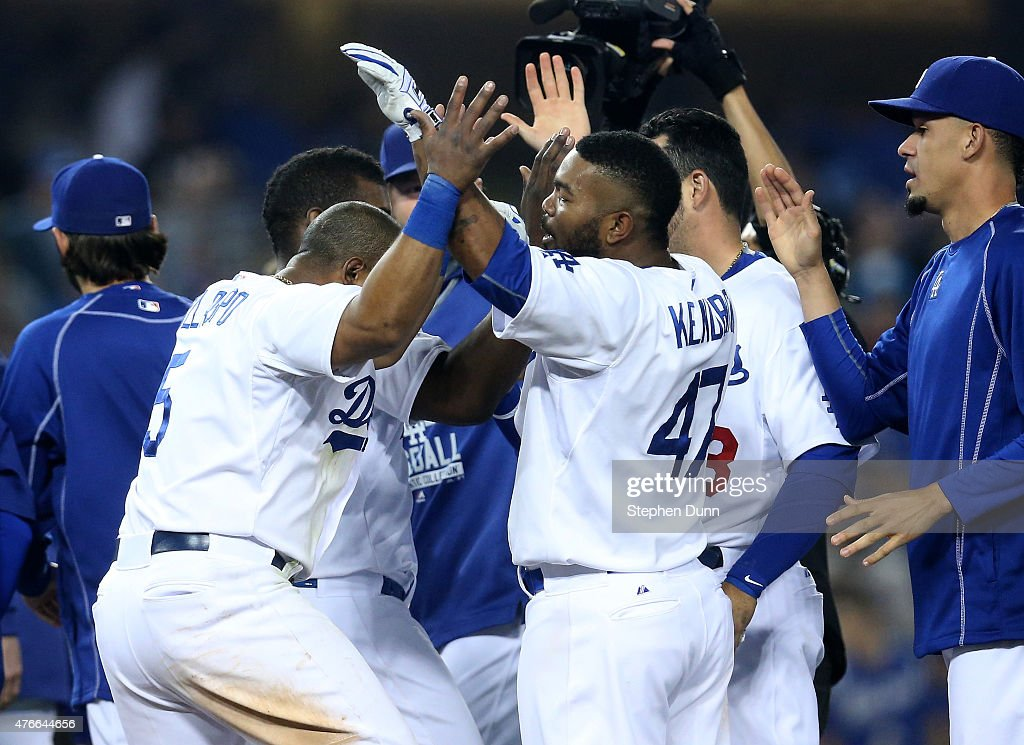 Howie Kendrick #47 of the Los Angeles Dodgers celebrates with teammates after hitting a walk off single in the ninth inning against the Arizona Diamondbacks at Dodger Stadium on June 10, 2015 in Los Angeles, California. The Dodgers won 7-6.