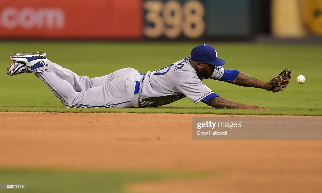 Howie Kendrick #47 of the Los Angeles Dodgers is unable to catch the ball in the seventh inning against the Philadelphia Phillies at Citizens Bank Park on August 4, 2015 in Philadelphia, Pennsylvania.