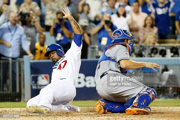 Howie Kendrick of the Los Angeles Dodgers slides home safely to score on a twoRBI double by Adrian Gonzalez of the Los Angeles Dodgers in the seventh...