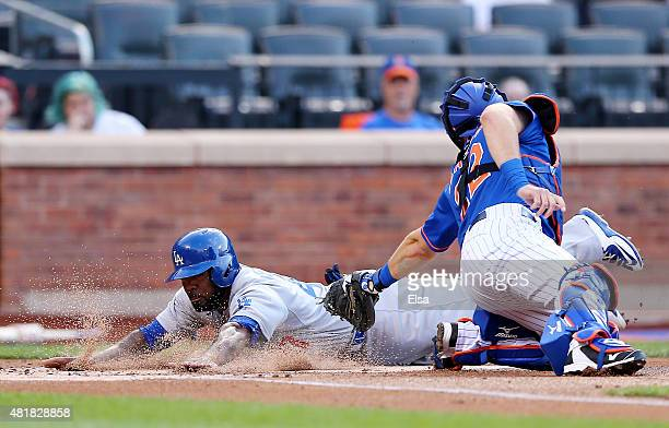 Howie Kendrick of the Los Angeles Dodgers slides safely past Kevin Plawecki of the New York Mets in the first inning on July 24 2015 at Citi Field in...