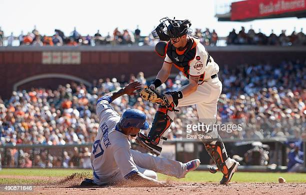 Howie Kendrick of the Los Angeles Dodgers slides safely past the tag of Trevor Brown of the San Francisco Giants to score on fielders choice hit by...