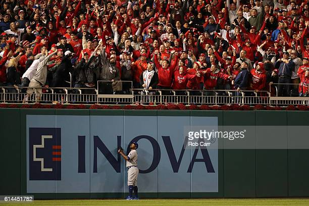 Howie Kendrick of the Los Angeles Dodgers watches a two run home run hit by Chris Heisey of the Washington Nationals in the seventh inning during...