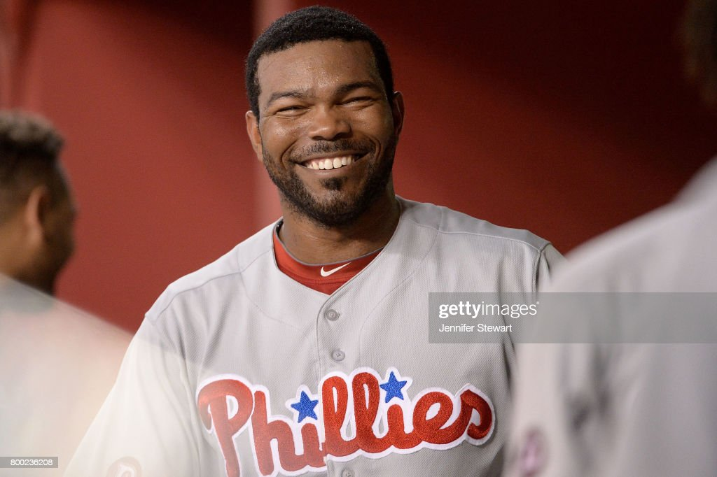Howie Kendrick #47 of the Philadelphia Phillies smiles in the dugout during the ninth inning of the MLB game against the Arizona Diamondbacks at Chase Field on June 23, 2017 in Phoenix, Arizona. The Philadelphia Phillies won 6-1.