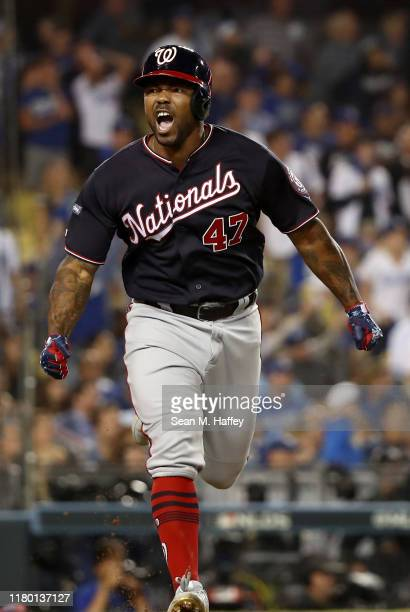 Howie Kendrick of the Washington Nationals celebrates after hitting a grand slam in the tenth inning of game five of the National League Division...
