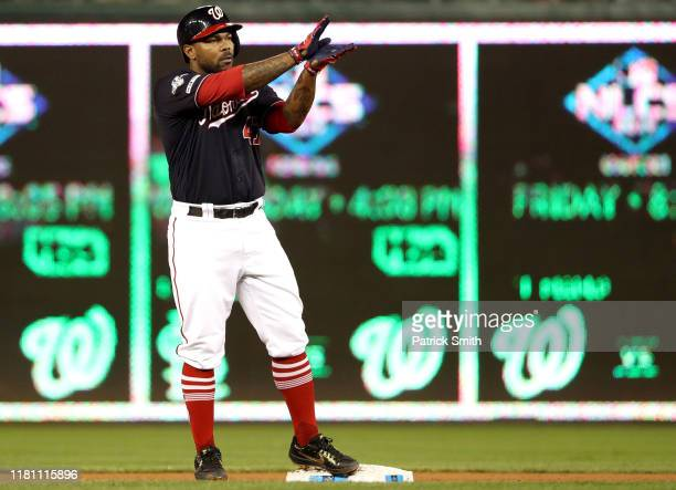 Howie Kendrick of the Washington Nationals celebrates by doing baby shark with his hands after his double in the seventh inning of game three of the...