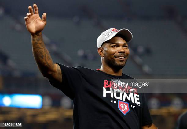 Howie Kendrick of the Washington Nationals celebrates defeating the Los Angeles Dodgers 73 in ten innings to win game five and the National League...