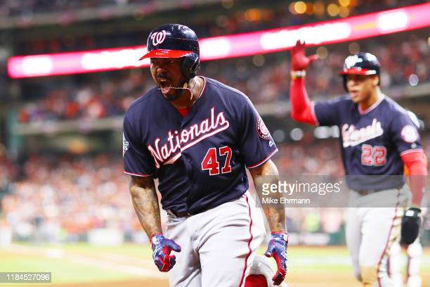 Howie Kendrick of the Washington Nationals celebrates his tworun home run against the Houston Astros during the seventh inning in Game Seven of the...