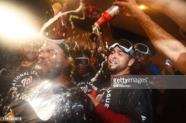 Howie Kendrick of the Washington Nationals celebrates with teammates in the clubhouse after they won game four and the National League Championship...