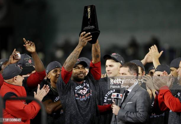 Howie Kendrick of the Washington Nationals celebrates with the trophy after winning game four and the National League Championship Series against the...