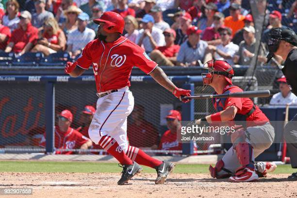 Howie Kendrick of the Washington Nationals drives in a run against the St Louis Cardinals during the sixth inning of a spring training game at The...