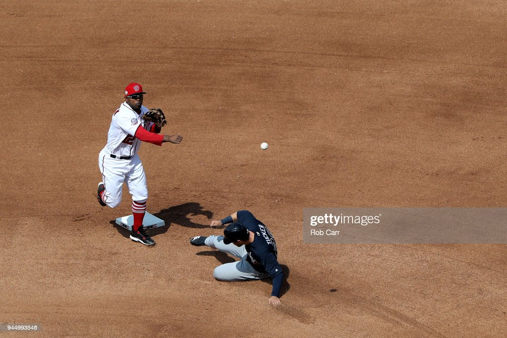 Howie Kendrick #12 of the Washington Nationals forces out Preston Tucker #20 of the Atlanta Braves at second base at Nationals Park on April 11, 2018 in Washington, DC.