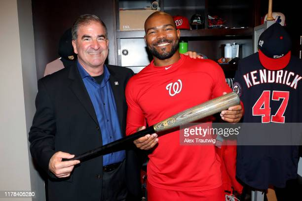 Howie Kendrick of the Washington Nationals gives the bat he hit the grand slam in Game 5 of the 2019 NLDS to the President of the Hall of Fame Museum...