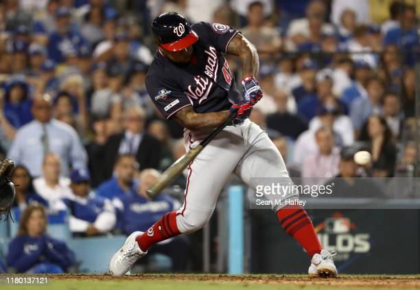 Howie Kendrick of the Washington Nationals hits a grand slam in the tenth inning of game five of the National League Division Series against the Los...