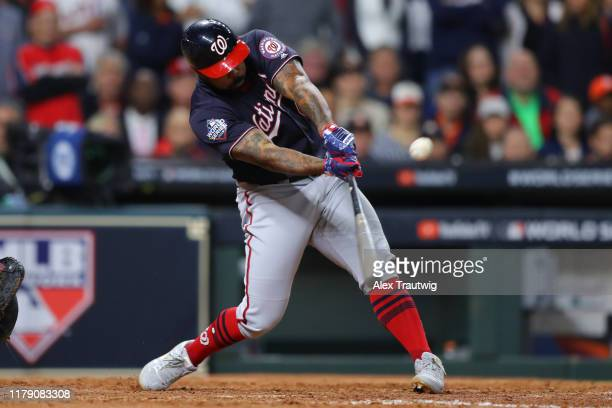 Howie Kendrick of the Washington Nationals hits a two-run home run in the seventh inning during Game 7 of the 2019 World Series between the...