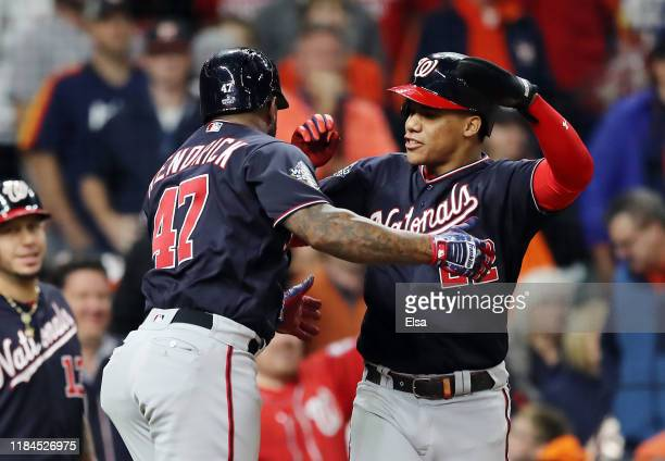 Howie Kendrick of the Washington Nationals is congratulated by his teammate Juan Soto after hitting a tworun home run against the Houston Astros...