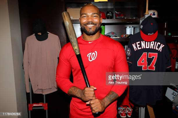Howie Kendrick of the Washington Nationals poses with the bat he hit the grand slam in Game 5 of the 2019 NLDS before giving it the National Baseball...