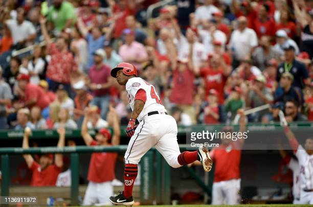 Howie Kendrick of the Washington Nationals rounds the bases after hitting the game winning home run in the eighth inning against the Pittsburgh...