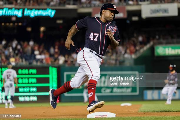 Howie Kendrick of the Washington Nationals rounds third base before scoring a run against the Cleveland Indians during the second inning at Nationals...