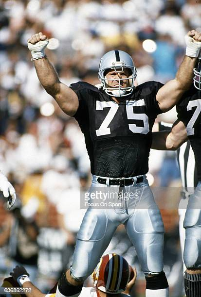 Howie Long of the Los Angeles Raiders celebrates after sacking the the quarterback of the Washington Redskins during an NFL game October 29 1989 at...