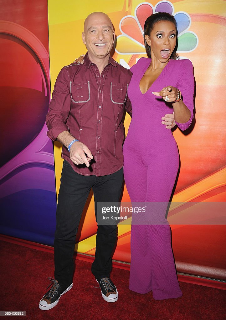 Howie Mandel and Melanie Brown arrive at the 2016 Summer TCA Tour - NBCUniversal Press Tour Day 1 at The Beverly Hilton Hotel on August 2, 2016 in Beverly Hills, California.