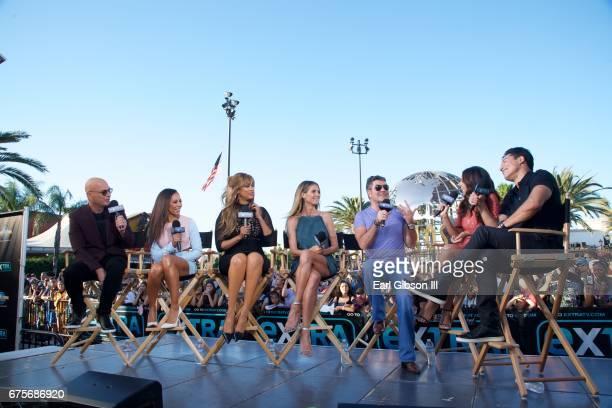 Howie Mandel Mel B Tyra Banks Heidi Klum Simon Cowell Terri Seymour and Mario Lopez speak on stage at 'Extra' at Universal Studios Hollywood on May 1...