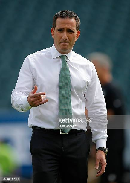 Howie Roseman General Manager of the Philadelphia Eagles watches his team warmup before a game against the Cleveland Browns at Lincoln Financial...