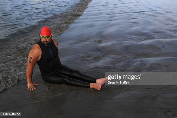 Howie Sanborn enters the ocean prior to competing during the Legacy Triathlon-USA Paratriathlon National Championships on July 20, 2019 in Long...
