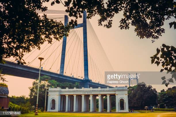 howrah bridge and princep hall in kolkata - kolkata stock pictures, royalty-free photos & images