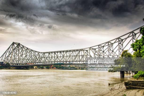 howrah bridge as viewed from the ganga ghat howrah - kolkata stock pictures, royalty-free photos & images