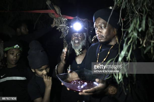 Howshua Amariel leader of the Beit Yisrael sect part of the African Hebrew Israelite Nation of Jerusalem preforms a prayer after the slaughter of a...