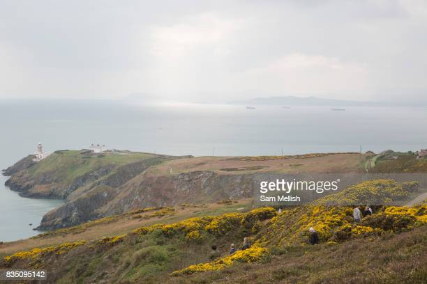 Howth cliff path overlooking Dublin Bay and Howth Lighthouse on 09th April 2017 in County Dublin Republic of Ireland Howarth Cliff Path at Howth Head...