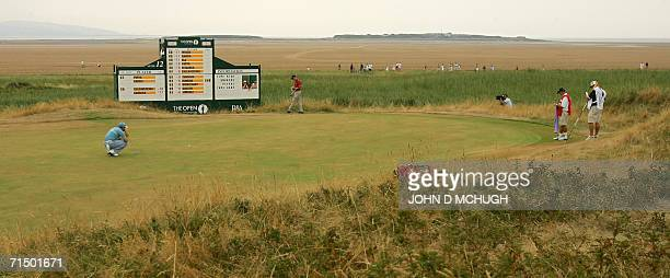 Spain's Sergio Garcia prepares to putt on the 13th green as he plays in the third round of the 135th British Open Golf Championships in Hoylake in...