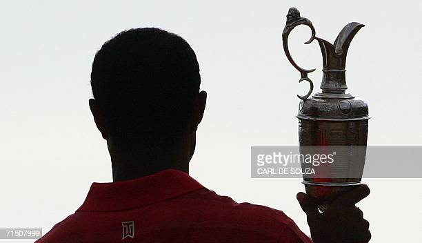 Tiger Woods of the United States poses with the Claret Jug after winning the 135th British Open Golf Championships in Hoylake in Liverpool in...
