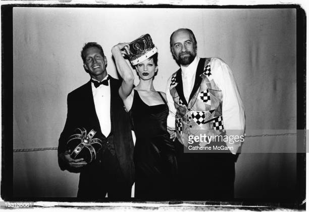 Hoyt Richards Kristen McMenamy and Mick Fleetwood pose for a photo at an AmFar Benefit at Webster Hall in February 1993 in New York City New York